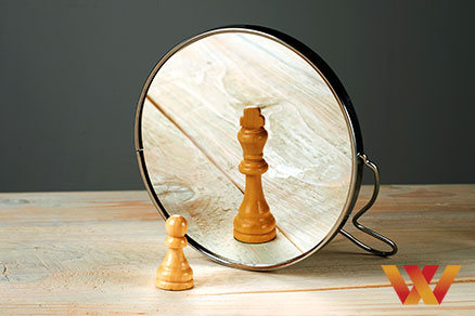 Pawn Cheese Piece with looking in a mirror with the Ego of the Executive King